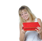 Woman smiling as she receives a present Royalty Free Stock Photography