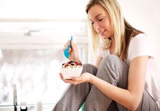 Woman smiling as she tucks into breakfast royalty free stock photography