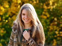 Woman smiling in autumn park Royalty Free Stock Photography