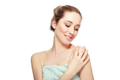 Woman smiling with bath towel Royalty Free Stock Images