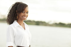 Woman smiling by the bay Stock Photos