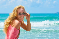 Woman smiling at the beach Stock Photo