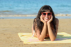 Woman smiling on beach vacation Stock Images