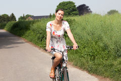 Woman smiling on bike Stock Photography