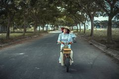 Woman Smiling While Biking on Road Near Trees during Daytime Royalty Free Stock Image