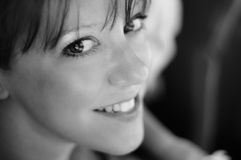 Woman Smiling. Black and White photo of a smiling woman Stock Photography