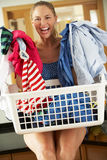 Woman Smiling At Camera With Laundry Basket Royalty Free Stock Photos