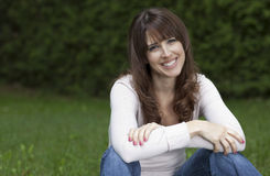 Woman smiling at the camera Stock Photo