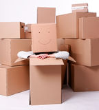 Woman with smiling cardboard boxes on head Stock Photo