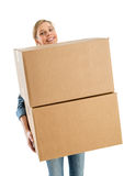 Woman Smiling While Carrying Stacked Cardboard Boxes royalty free stock image