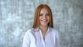 Woman smiling closeup portrait. Young business woman professional looking at camera happy. Portrait of a smiling. Portrait of a smiling redheaded girl. Woman stock video