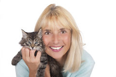Woman smiling and cuddling a kitten Royalty Free Stock Photography