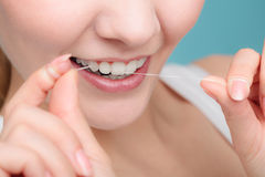 Woman smiling with dental floss. Royalty Free Stock Photography