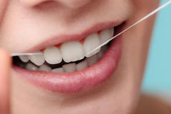 Woman smiling with dental floss. stock images