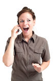 Woman smiling while discussing by cell phone Royalty Free Stock Photo