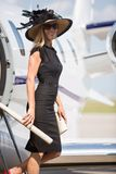 Woman Smiling While Disembarking Private Jet Royalty Free Stock Images