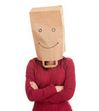 Woman in smiling ecological paper bag on head Stock Image