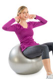 Woman Smiling While Exercising On Pilates Stock Photo