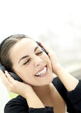 Woman smiling with eyes closed and wearing headphones Royalty Free Stock Images