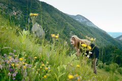 Woman smiling in a field of flowers Royalty Free Stock Images