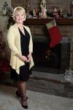 Woman smiling fireplace Christmas Royalty Free Stock Image