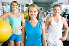Woman smiling  in front of a group of gym people Royalty Free Stock Image