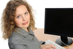 Woman smiling in front of her computer Royalty Free Stock Photography