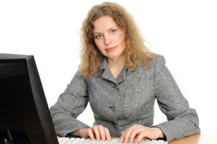 Woman smiling in front of her computer Stock Image