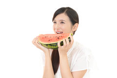 Woman smiling with fruit Royalty Free Stock Image