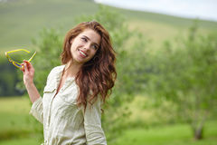 Woman smiling happy on sunny summer day outs Royalty Free Stock Images