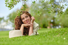 Woman smiling happy on sunny summer or spring day Stock Photos