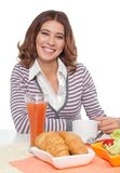 Woman smiling having breakfast Royalty Free Stock Image