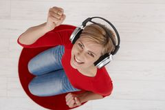 Woman smiling with headphones Stock Photos