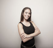Woman smiling with her arms crossed Royalty Free Stock Photography