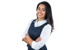 Woman smiling with her arms folded Royalty Free Stock Images