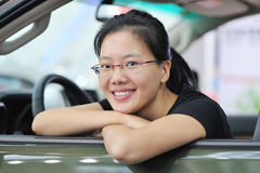 Woman smiling in her car Royalty Free Stock Photo