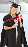 Woman smiling at her graduation Royalty Free Stock Image