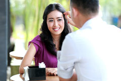 Woman smiling when her hair touched by her boyfriend Royalty Free Stock Photo
