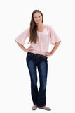 Woman smiling with her hands on her hips Royalty Free Stock Photo