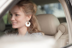 Woman smiling in her new car Stock Photos