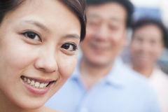 Woman smiling with her parents, portrait, focus on foreground Royalty Free Stock Images