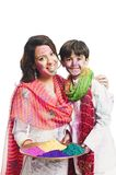Woman smiling with his son on Holi Stock Image