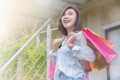 Woman smiling and hold shopping bug , she happy time on the day mid year sale royalty free stock images