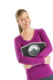 Woman Smiling While Holding Bathroom Scale Stock Photography
