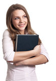 Woman smiling while holding book Stock Photography