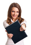 Woman smiling while holding book Royalty Free Stock Photos