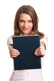 Woman smiling while holding book Stock Photo
