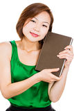 Woman smiling holding book happily Royalty Free Stock Photos