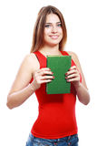 Woman smiling while holding book Royalty Free Stock Images