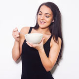 Woman smiling while holding a bowl. Stock Photo